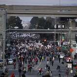 Hundreds of Occupy activists march down Adeline Street to the Port of Oakland in hopes to suit it down, Monday December 12, 2011, in Oakland, Calif. This was part of a West Coast protest in port cities.