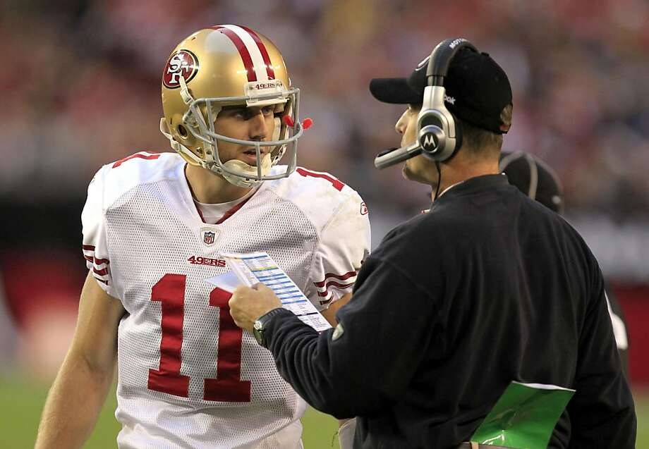San Francisco 49ers head coach Jim Harbaugh, right, talks with Alex Smith (11) during the fourth quarter in an NFL football game against the Arizona Cardinals, Sunday, Dec. 11, 2011, in Glendale, Ariz.  The Cardinals defeated the 49ers 21-19.(AP Photo/Ralph Freso) Photo: Ralph Freso, AP