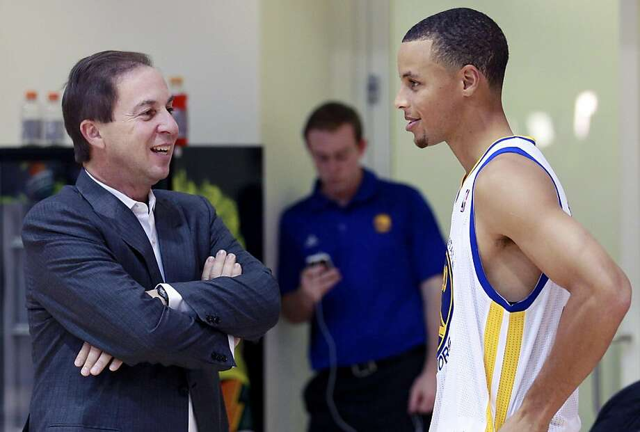 Golden State Warriors owner Joe Lacob, left, talks to Warriors guard Stephen Curry during an NBA basketball media day in Oakland, Calif., Monday, Dec. 12, 2011. Photo: Jeff Chiu, AP