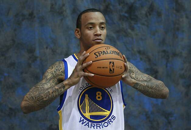 Golden State Warriors' Monta Ellis (8) poses for photographs at an NBA basketball training facility in Oakland, Calif., Monday, Dec. 12, 2011. (AP Photo/Jeff Chiu) Photo: Jeff Chiu, AP