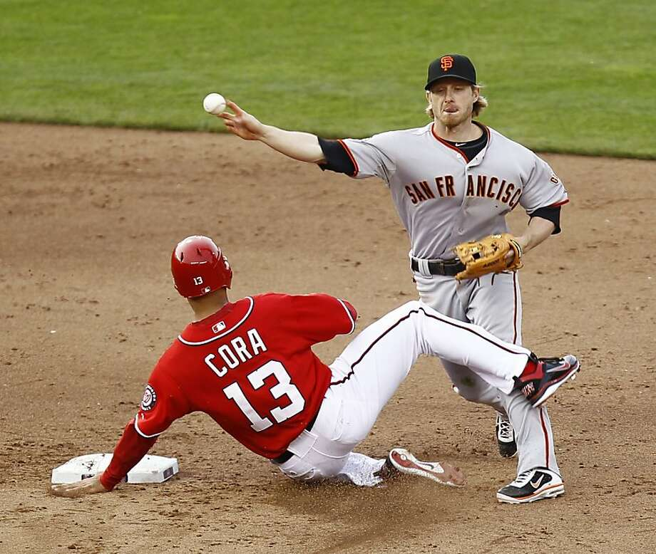San Francisco Giants shortstop Mike Fontenot attempts a double play as Washington Nationals' Alex Cora (13) is forced out during the ninth inning of an MLB baseball game, Saturday, April 30, 2011 in Washington.  The Giants won 2-1. (AP Photo/Luis M. Alvarez) Photo: Luis Alvarez, AP