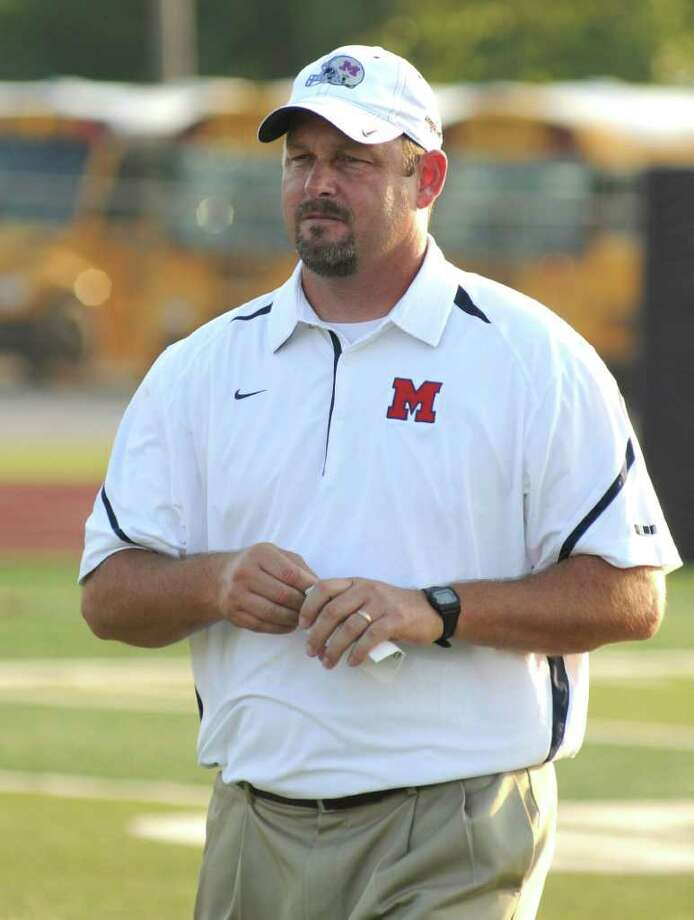 L. SCOTT HAINLINE: FOR THE CHRONICLE TOP BOSS: Manvel football head coach Kirk Martin and the Mavericks are set to take on Aledo for the Class 4A Division II state championship on Saturday in Arlington. Photo: L. Scott Hainline / freelance
