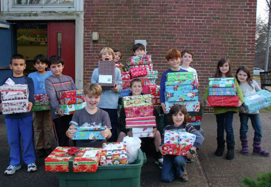 "Hindley celebrates ""Holiday Hope"" with hope chests. The students pose with presents. Photo: Contributed Photo"