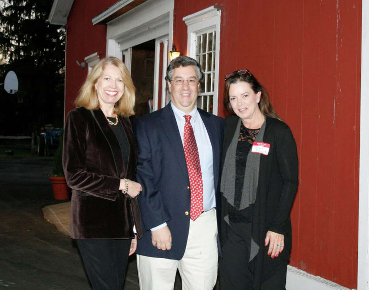 Enjoying the barn tour at the recent benefit for NCTV79 at the historic Crajah house are Emily Restifo, First Selectman Rob Mallozzi and Debbie McQuilken, benefit committee.