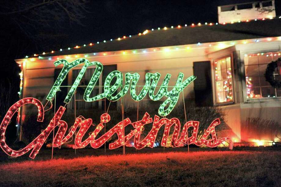 Residents of Greater Danbury are decorating their homes for the holidays, as this Bethel family did in this photo from last year. Photo: Carol Kaliff