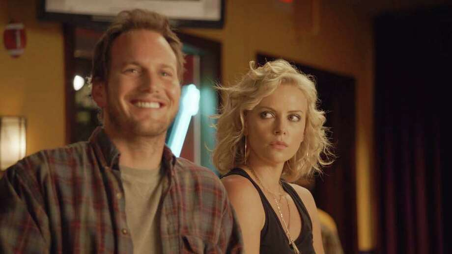 """In this image released by Paramount Pictures, Patrick Wilson, left, and Charlize Theron are shown in a scene from """"Young Adult."""" Photo: AP"""