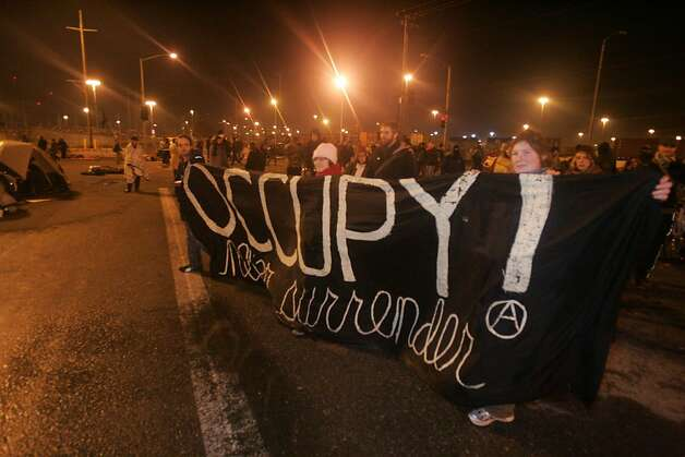 Protestors march outside terminal 43 at the Port of Oakland after Occupy Oakland forced a shut down of the shipping facility on Monday, Dec. 12, 2011 in Oakland, Calif. Photo: Mathew Sumner, Special To The Chronicle