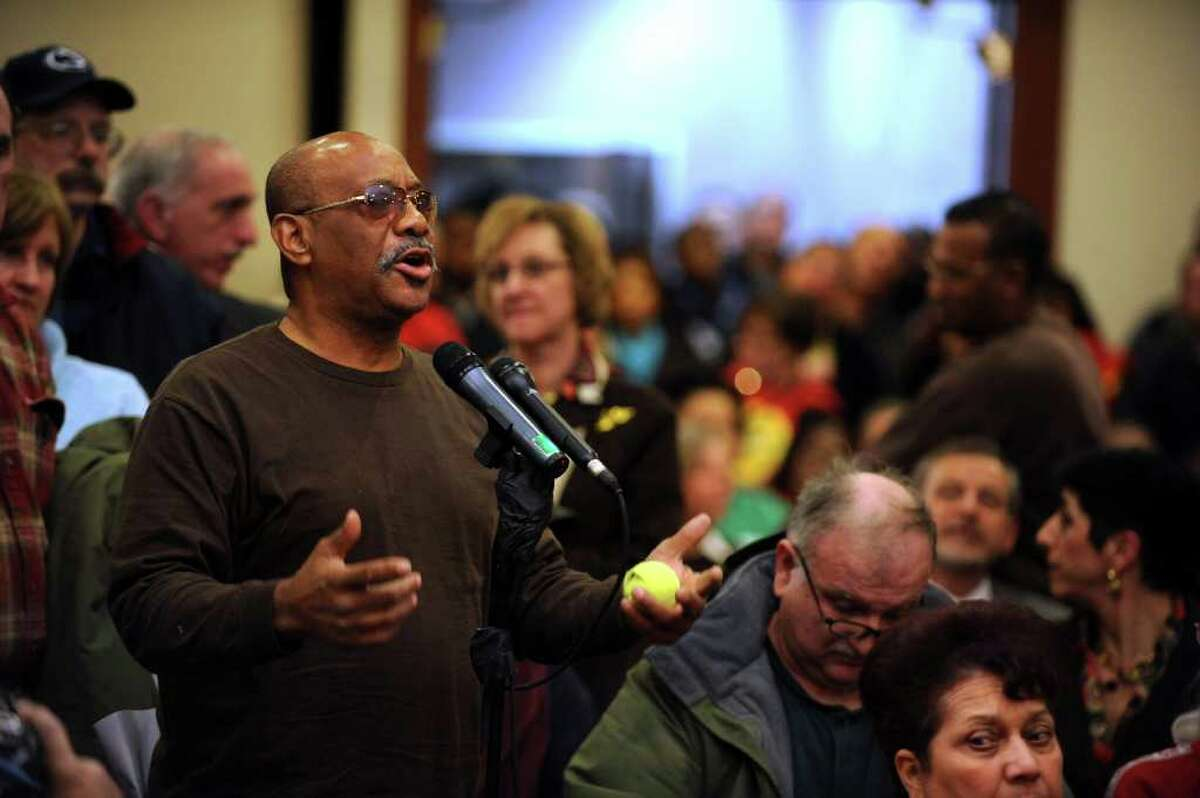 Cecil Young of Bridgeport asks Gov. Dan Malloy a question during a town hall meeting in City Hall Annex in Bridgeport, Conn. on Feb. 21, 2011. The meeting was the first of 17 Malloy held around the state.