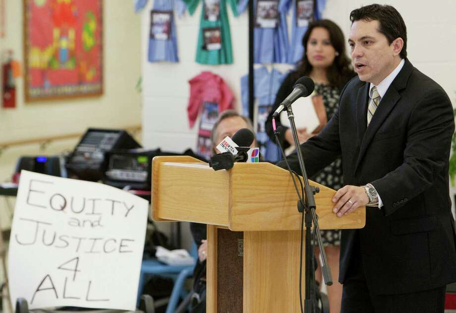 "David Hinojosa, MALDEF southwest regional counsel, speaks during a news conference announcing the lawsuit in December 2011. The Edgewood grad says ""Savage Inequalities: Children in America's Schools,"" Jonathan Kozol's 1991 book about school funding in the Edgewood and Alamo Heights ISDs, prompted him to focus on law. Photo: Darren Abate, SPECIAL TO THE EXPRESS-NEWS / SAN ANTONIO EXPRESS-NEWS"