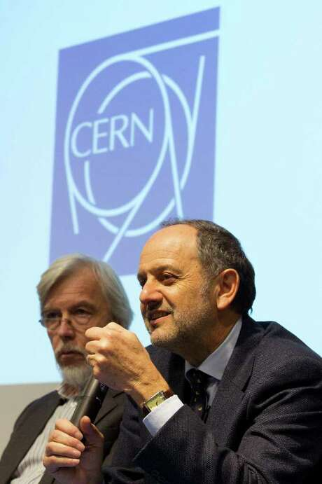 German Rolf-Dieter Heuer, left, Director General of CERN (the European particle physics laboratory), and Professor Guido Tonelli, right, CMS Collaboration Spokesperson, inform to media about the Higgs search, during a press conference at CERN, in Geneva, Switzerland, Tuesday, Dec.  13, 2011. The research team searching for the sub-atomic particle believed to be a basic building block of the universe announced Tuesday that new data appears to show the likely place where the Higgs boson will be found. Photo: Salvatore Di Nolfi, AP / KEYSTONE