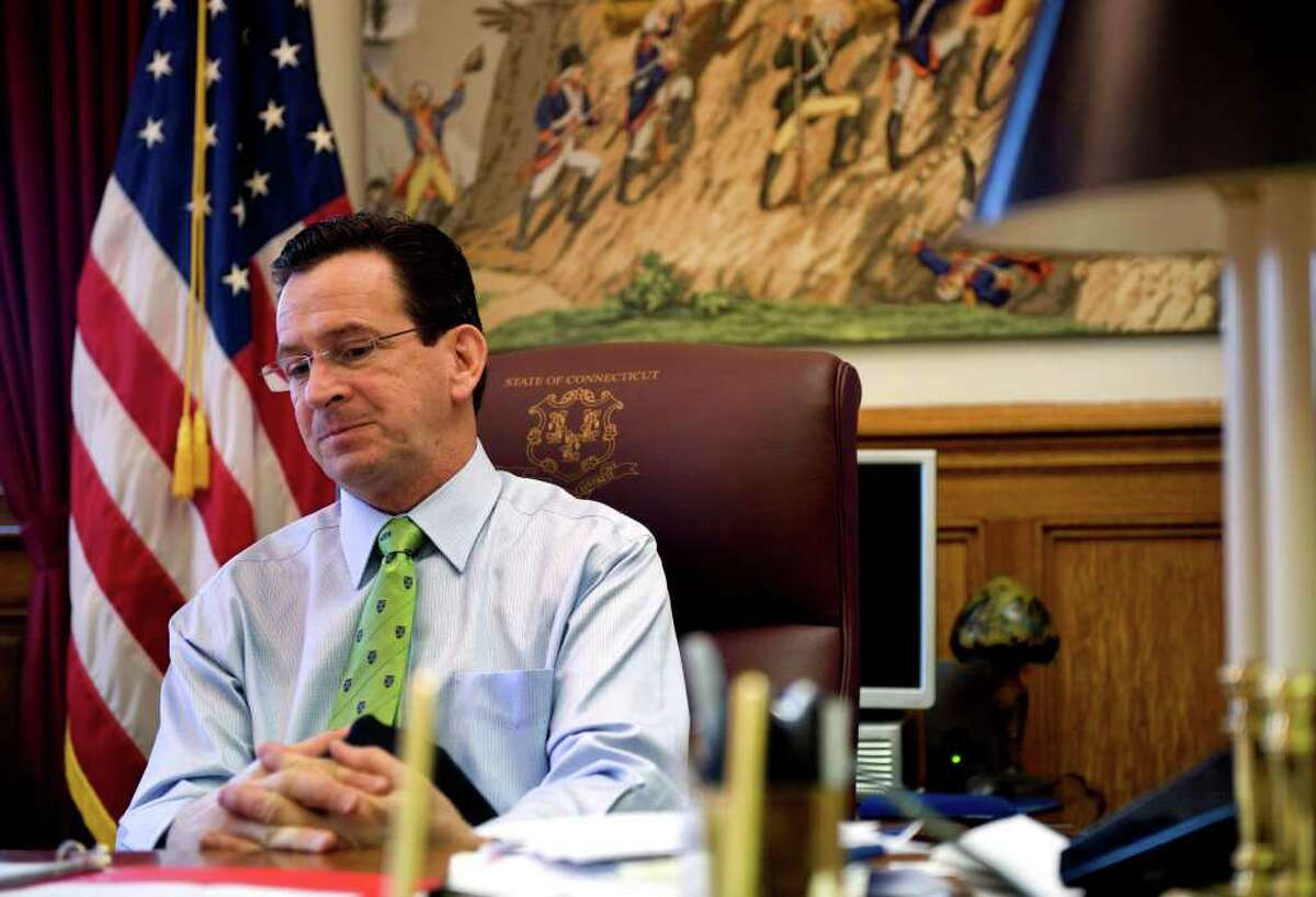 Gov. Dan Malloy prepares for a press conference at the state Capitol in Hartford, Conn. on Thursday April 15, 2011. A budget was near.