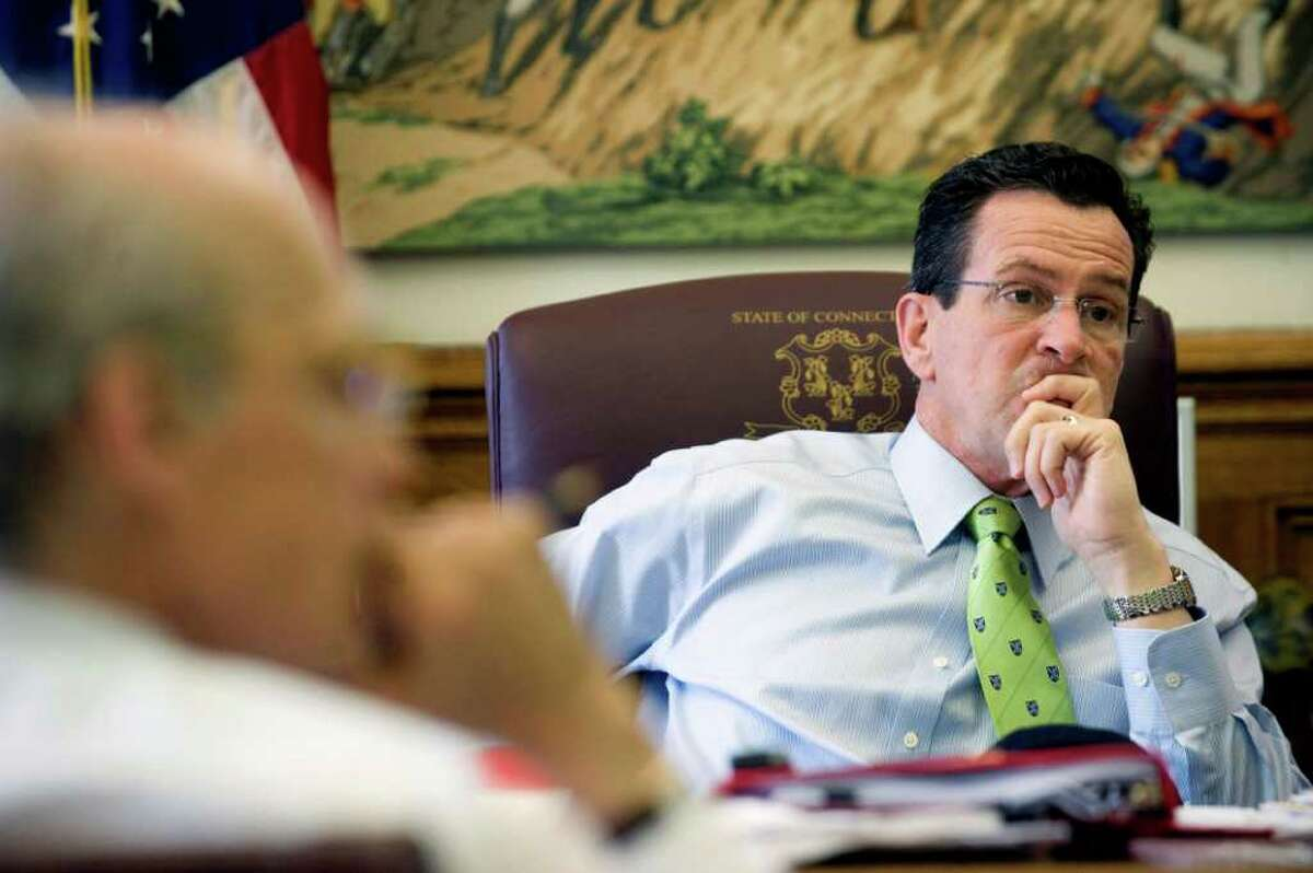 Gov. Dan Malloy in his office with Tim Bannon at the state Capitol in Hartford, Conn. on Thursday April 15, 2011. A budget was near.