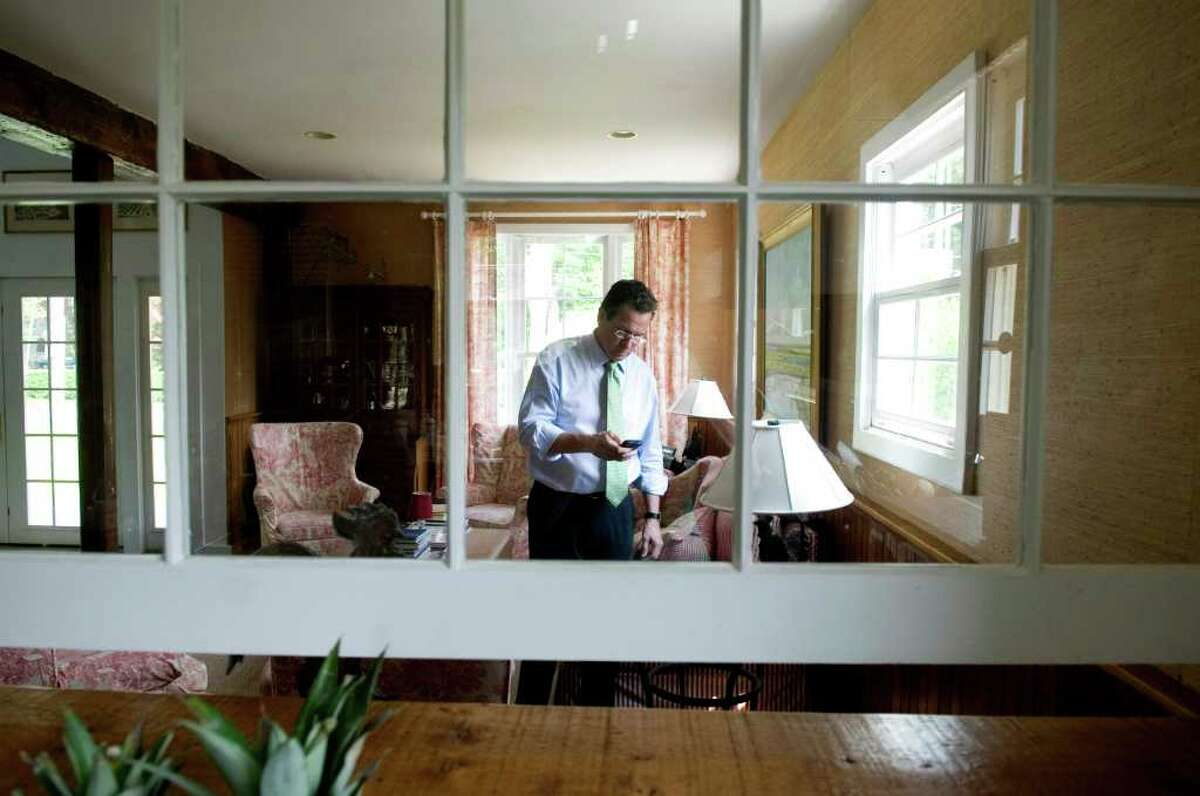 Gov. Dan Malloy stops by his Shippan home to check on things and make some phone calls during a visit to Stamford, Conn. on Thursday May 19, 2011. The Malloy's put their house on the market and eventually leased out for two years after moving to Hartford.