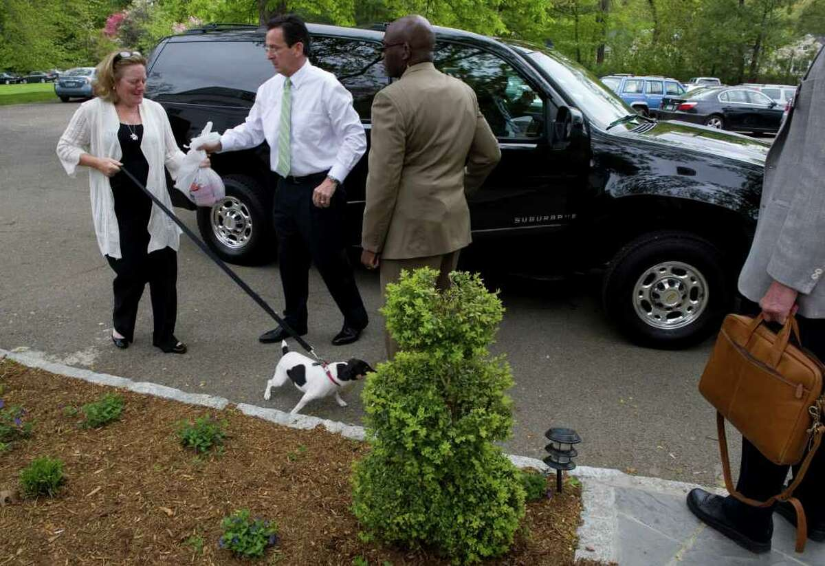 Gov. Dan Malloy says goodbye to his wife Cathy as gets ready to leave the Hartford residence and head to Fairfield County for several stops on Wednesday May 11, 2011.