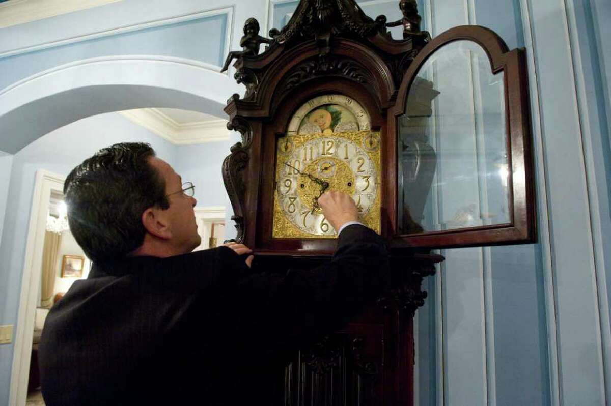 Gov. Dan Malloy winds a grandfather clock in the Governor's Mansion in Hartford, Conn., October 27, 2011.