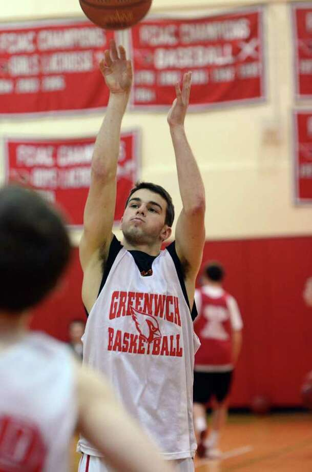 Greenwich's Alejandro Rodriguez practices during boys basketball practice at Greenwich High School on Tuesday, Dec. 13, 2011. Photo: Amy Mortensen / Connecticut Post Freelance