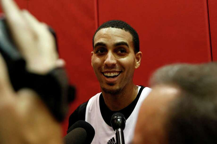 Rockets guard Kevin Martin takes questions from the media during the Houston Rockets training camp at the Toyota Center Tuesday, Dec. 13, 2011, in Houston. Photo: Johnny Hanson, Houston Chronicle / © 2011 Houston Chronicle