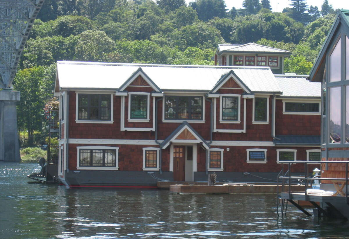 The city of Seattle says this large Lake Union houseboat is likely illegal, because it resembles a floating home, but doesn't follow floating-home codes on size and environmental practices. The owner has said the house is a