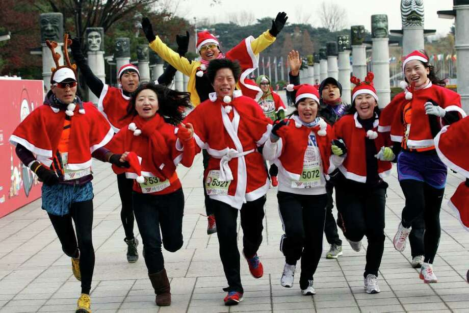 South Koreans wearing Santa Claus costumes take part in the Santa Marathon race in Seoul, South Korea, Saturday, Dec. 10, 2011. More than 1,000 people participated in the 5-kilometer (3.1 miles) charity run to raise money for the poor as Christmas is one of the biggest holidays in South Korea, where over half of the population are Christians. Photo: Lee Jin-man, Associated Press / AP