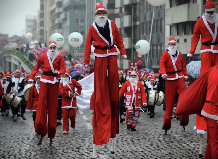 Performers dressed as Santa Claus participate in the annual Santa Claus parade, in Porto, Portugal,