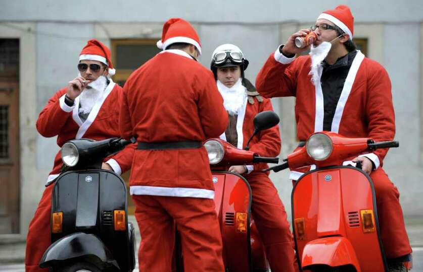 People dressed as Santa Claus take part in the annual Santa Claus parade in Porto, on December 11, 2
