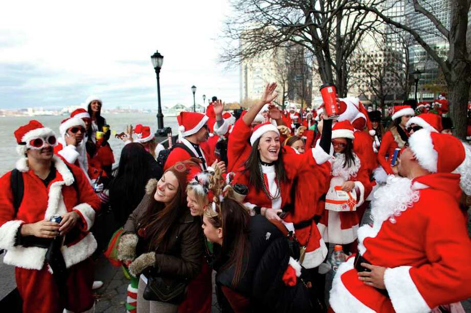 Revelers dressed as Santa Claus sing near Battery Park during the annual SantaCon event December 10, 2011 in New York City. Photo: Allison Joyce, Getty / 2011 Getty Images