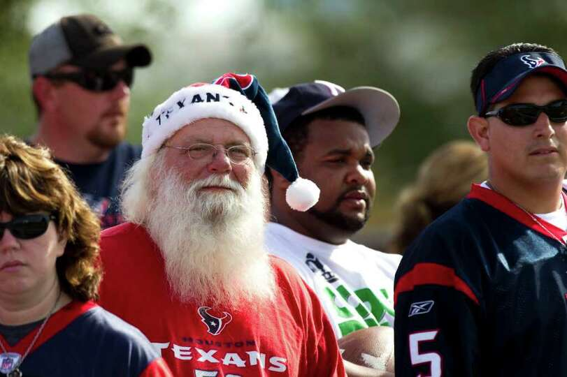 Houston Texans fan Mark Hulsey, white beard, watches practice during Texans training camp at the Met