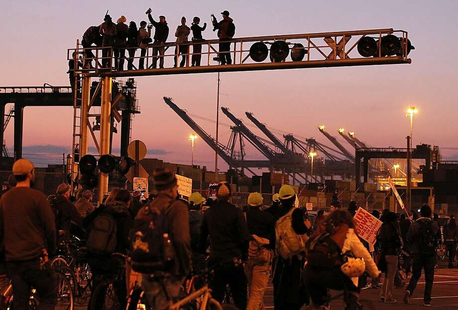 OAKLAND, CA - DECEMBER 12:  Occupy protestors stand on a railroad crossing during a march at the Port of Oakland on December 12, 2011 in Oakland, California. Following a general strike coordinated by Occupy Oakland that closed the Port of Oakland on November 2, Occupy Wall Street protestors are attempting to shut down all West Coast ports in Los Angeles, San Diego, Oakland, Portland, Seattle and Tacoma.  (Photo by Justin Sullivan/Getty Images) Photo: Justin Sullivan, Getty Images