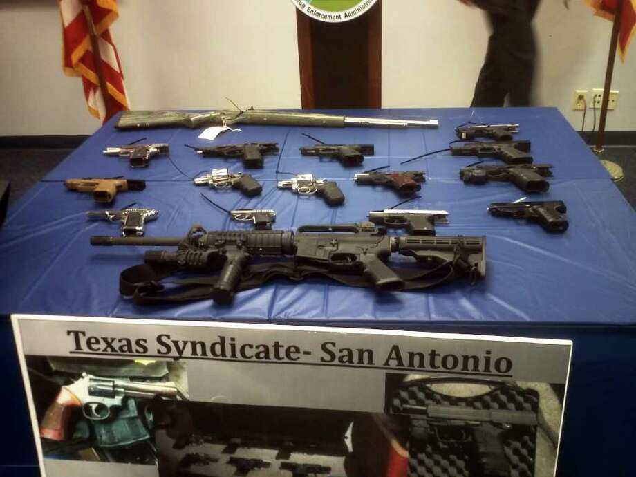 These weapons were seized from members of the Texas Syndicate during an 18-month investigation. The probe led to 18 people being indicted. Photo: Guillermo Contreras/gcontreras@express-news.net