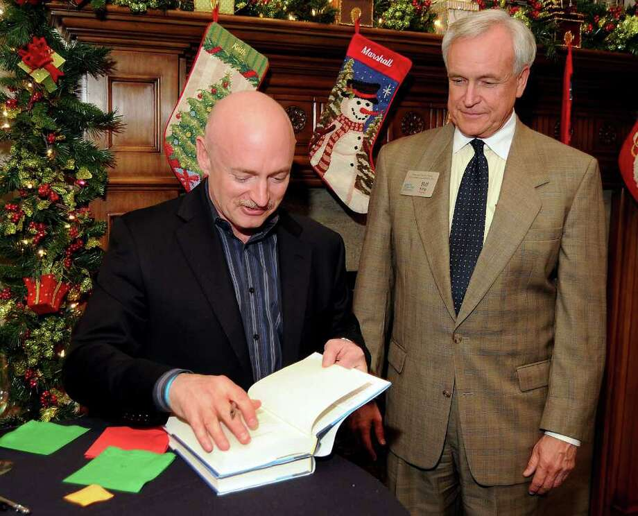 "Former NASA astronaut Mark Kelly autographs the newly released ""Gabby: A Story of Courage and Hope"" for Bill King at a Dec. 13 VIP reception,wine tasting and book signing celebrating at the home of Alice and Keith Mosing. Photo: Dave Rossman, For The Chronicle / © 2011 Dave Rossman"