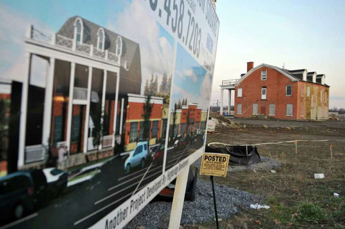 The Ingersoll mansion, previously moved to a new location on the site of the Mansion Square shopping plaza, will be moved again and become a bank, after the town of Niskayuna got approval to open the road connecting Balltown Road and State Street through the new plaza. Shown here on Tuesday Dec. 13, 2011 in Niskayuna, N.Y. (Philip Kamrass / Times Union )