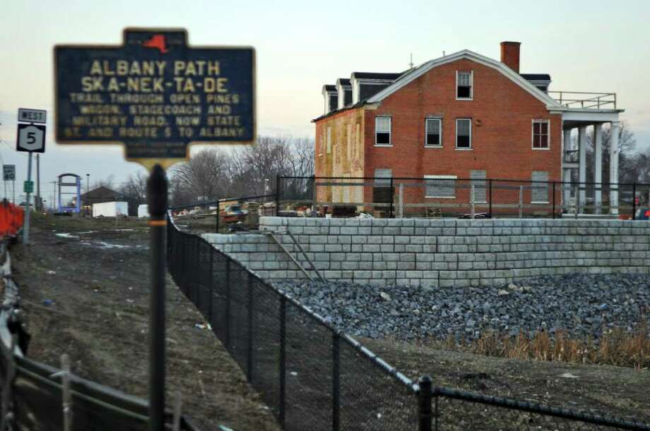 The Ingersoll mansion, previously moved to a new location on the site of the Mansion Square shopping plaza, will be moved again and become a bank, after the town of Niskayuna got approval to open the road connecting Balltown Road and State Street through the new plaza. Shown here on Tuesday Dec. 13, 2011 in Niskayuna, N.Y.    (Philip Kamrass / Times Union ) Photo: Philip Kamrass / 00015774A