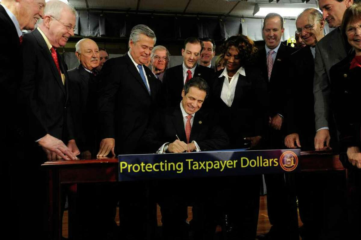 Governor Andrew Cuomo signs a new law aimed at reducing the MTA payroll tax in West Hempstead, N.Y. Monday Dec. 12, 2011. (Darren McGee-Office of the Governor)