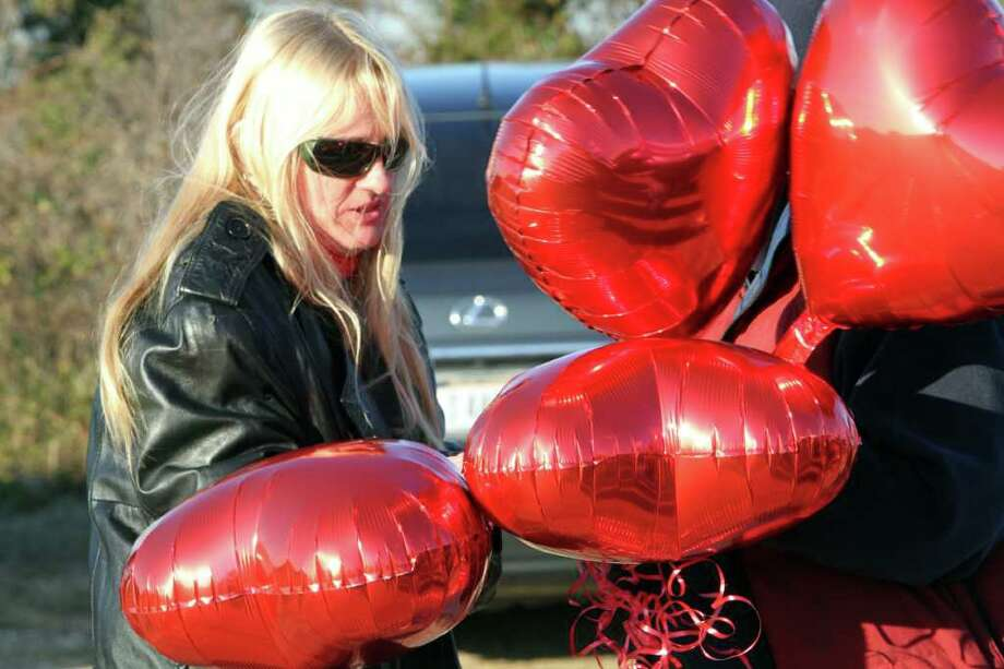Mary Gilbert, mother of Shannan Gilbert,  prepares to release balloons in her honor during a vigil in Babylon, N.Y., Tuesday, Dec. 13, 2011, after police found what they believe to be the remains of Shannan Gilbert, who they believe went missing in December 2011 after meeting a client for a sexual encounter. With the discovery of bones shortly after 9 a.m., police on New York's Long Island announced Tuesday that they believe they have discovered Gilbert's remains in a dense wetland thicket.(AP Photo/Mary Altaffer) Photo: Mary Altaffer
