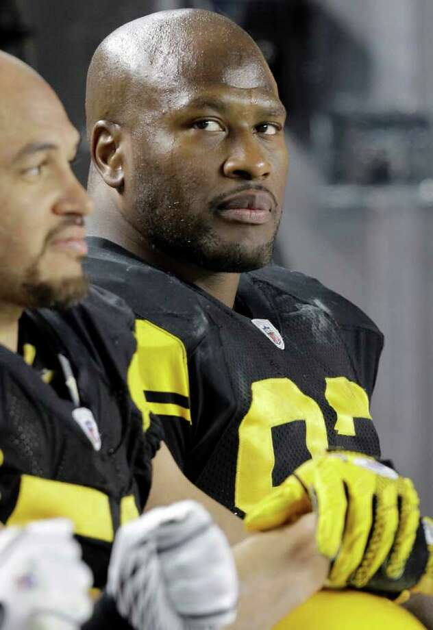 FILE - In this Dec. 8, 2011, file photo, Pittsburgh Steelers linebacker James Harrison, right, sits on the bench during the third quarter of an NFL football game against the Cleveland Browns in Pittsburgh.  Harrison has been suspended for one game without pay for his hit last week on Browns quarterback Colt McCoy.  NFL executive vice president Ray Anderson said Tuesday, Dec. 13, 2011, the suspension is the result of Harrison's fifth illegal hit against a quarterback in the past three seasons. (AP Photo/Gene J. Puskar, File) Photo: Gene J. Puskar