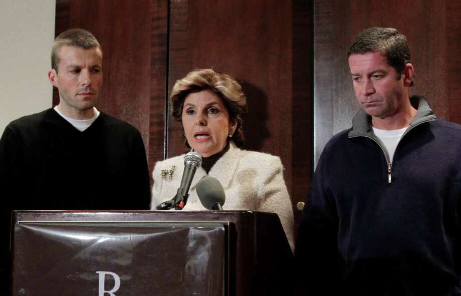 Former Syracuse ball boys Bobby Davis, left,  and Mike Lang, right,  flank attorney Gloria Allred during a news conference, Tuesday, Dec. 13, 2011, in New York. The men say they were molested by former assistant Syracuse basketball coach Bernie Fine and have sued the school and men's basketball coach Jim Boeheim for defamation. (AP Photo/Richard Drew) Photo: Richard Drew