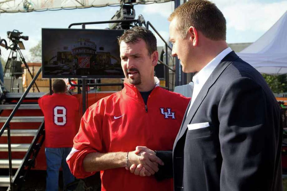 A HECTIC TIME: UH athletic director Mack Rhoades, left, meeting ESPN's Kirk Herbstreit, has had an eventful year, including the school's hosting College GameDay for the first time. The months ahead promise to be busy as well. Photo: Smiley N. Pool / © 2011  Houston Chronicle