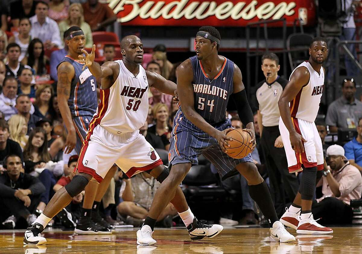 MIAMI, FL - APRIL 08: Kwame Brown #54 of the Charlotte Bobcats posts up Joel Anthony #50 of the Miami Heat during a game at American Airlines Arena on April 8, 2011 in Miami, Florida. NOTE TO USER: User expressly acknowledges and agrees that, by downloading and/or using this Photograph, User is consenting to the terms and conditions of the Getty Images License Agreement. (Photo by Mike Ehrmann/Getty Images)