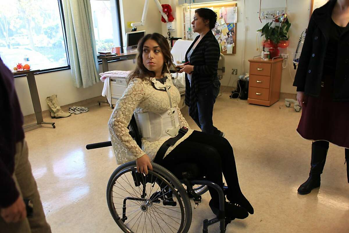 Katy Sharify, who received stem cell therapy before the study she was part of was cancelled heads to the Day Room from her hospital room at Santa Clara Valley Medical Center on Tuesday, December 13, 2011 in San Jose, Calif.