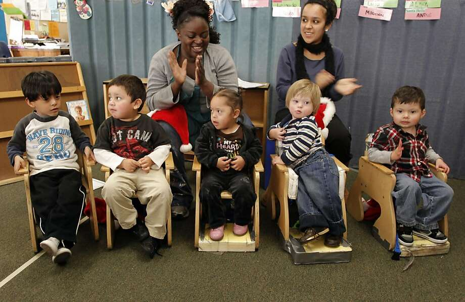 Teachers, Katina Jones, (left) and Jeanette Ortiz, sings songs with children, (left to right) Jesus, Omar, Madison, Andre and Eric, on Tuesday December 13, 2011, in Richmond, Ca., at the George Miller Center of ARC, (Advocacy Respect Commitment), which runs programs for the developmentally disabled.  Programs such as ARC will loss funds due to California budget cuts. Photo: Michael Macor, The Chronicle