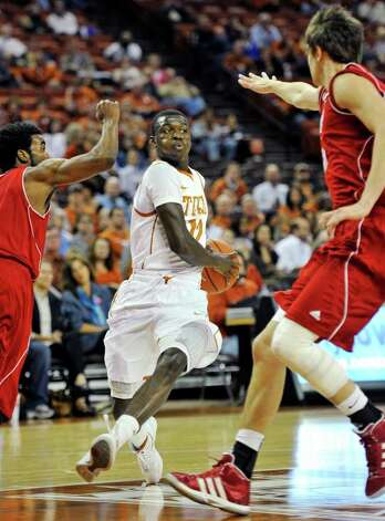 Texas guard Myck Kabongo, center, drives down the lane against Nicholls State guard Bryan Hammond, left, and forward Sam McBeath, right, during the first half of an NCAA college basketball game, Tuesday, Dec. 13, 2011, in Austin. Photo: Michael Thomas, Associated Press / FR65778 AP