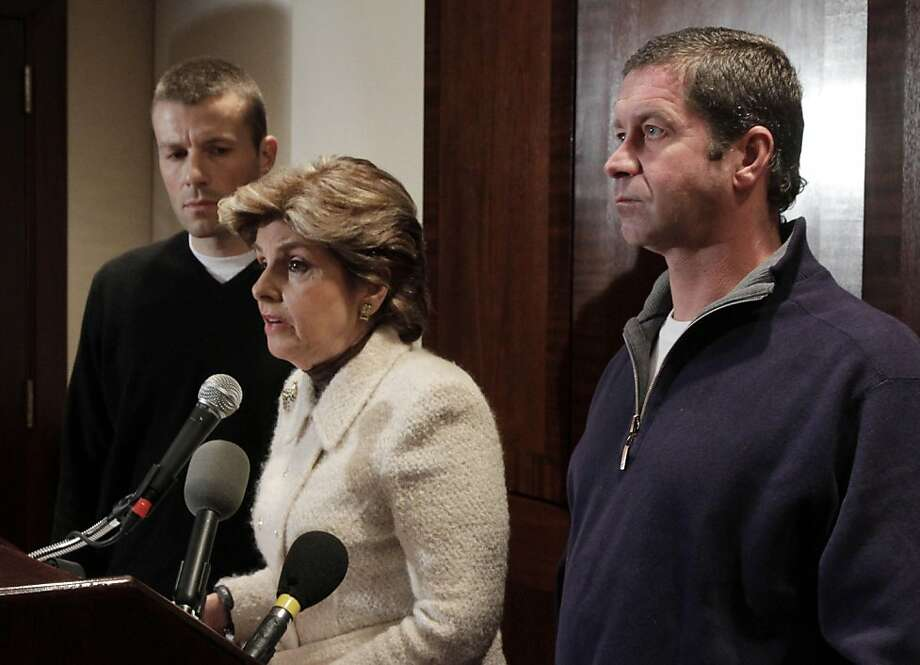 Former Syracuse ball boys Bobby Davis, left, and Mike Lang, right, flank attorney Gloria Allred during a news conference, Tuesday, Dec. 13, 2011, in New York. The men say they were molested by assistant Syracuse basketball coach Bernie Fine and have sued the school and men's basketball coach Jim Boeheim for defamation. (AP Photo/Richard Drew) Photo: Richard Drew, AP
