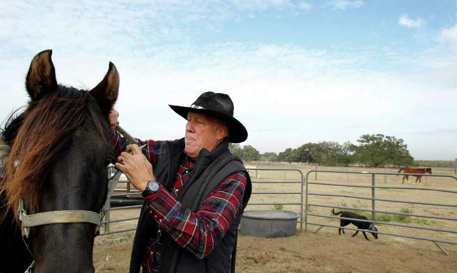 "Pastor Jim VonShounmacher prepares to ride Adino Ole, grandson of the horse used in the film ""The Black Stallion,"" at MorningStar Ministries in Somerset. Photo: MICHAEL MILLER, SAN ANTONIO EXPRESS-NEWS / mmiller@express-news.net"