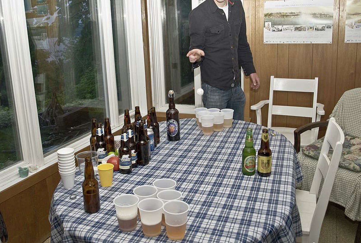In this file photo, a teen tries his hand at beer pong, a popular drinking game.