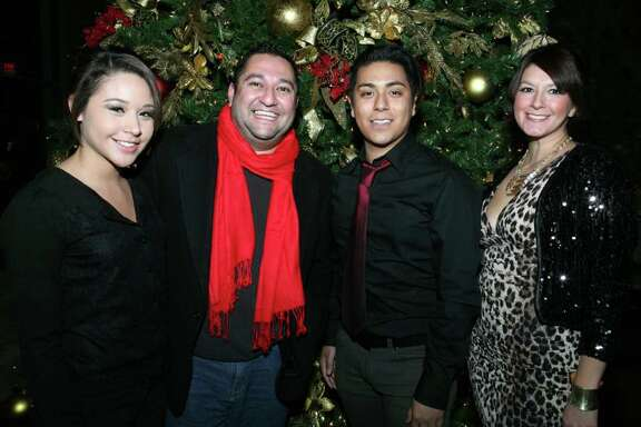 Volunteer Karla Zuniga (from left), co-producer Josue Pacheco, volunteer Aaron Salas and co-producer Erica Torres get together during the Threads For Hope fashion show benefiting the San Antonio AIDS Foundation at the Hotel Contessa.