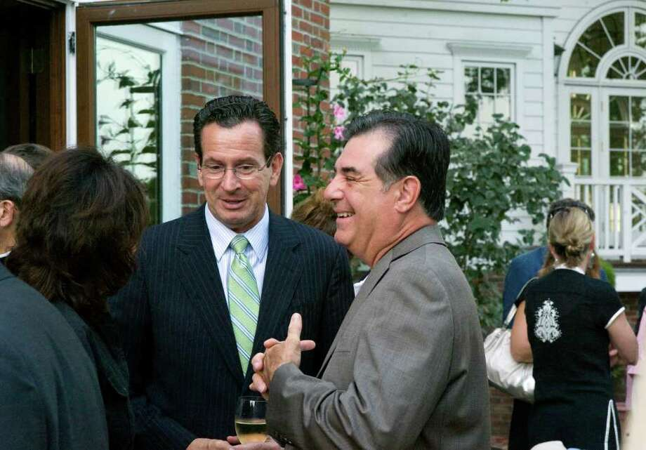 "Gov. Dan Malloy and Stamford Mayor Michael Pavia socialize at the home of Robert Dilenschneider. Dilenschneider hosted former Secretary of State Henry Kissinger at his home in Darien, Conn.to discussed his new book, ""On China"" on July 28, 2011. Dilenschneider was a key source of information as Malloy sought to keep UBS from leaving Stamford. Photo: Keelin Daly / Stamford Advocate"