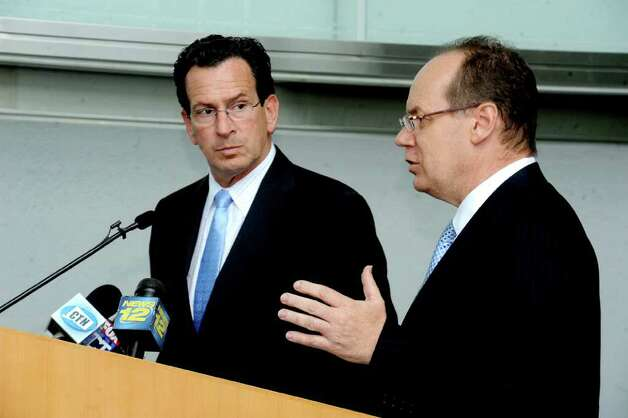 Conn. Gov. Dan Malloy and UBS Americas Chief Executive Phil Lofts in a press conference in the UBS building in Stamford, Conn. on Tuesday, August 23, 2011 to announce UBS committed to staying in Stamford for five years, in exchange for a generous package of incentives. Photo: Lindsay Niegelberg / Stamford Advocate