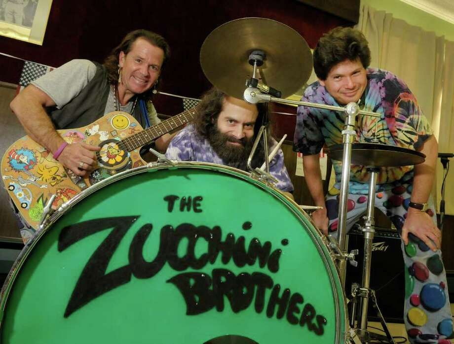 The Zucchini Brothers, from left, Jack Zucchini, Sam Zucchini and Steve Zucchini, pose for a photograph following a performance at the VFW Chandler Young Post 8162 on Sunday, Dec. 4, 2011 in Nassau, NY.    (Paul Buckowski / Times Union) Photo: Paul Buckowski / 00015647A