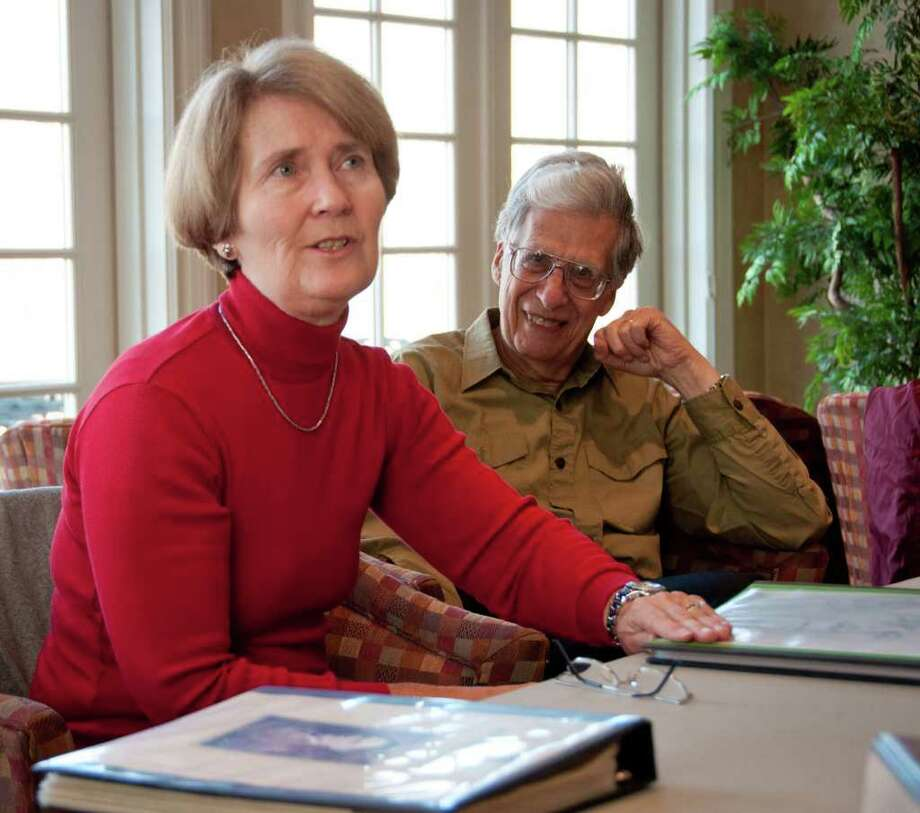 Judy Rummo, left, describes the genealogy book she made about her father. This photo was taken on Wednesday, December 14, 2011. Photo: Patricia Keeler / The News-Times