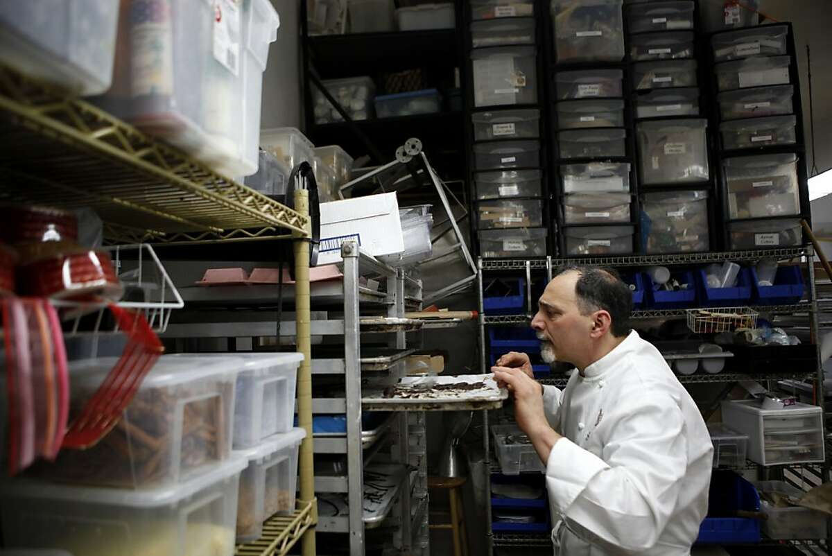 Paul Masse searches his kitchen for the accoutrement to his Black Forest Buche de Noel cake in his bakery, Masse's Pastries, Thursday, December 8, 2011 in Berkeley, Calif.